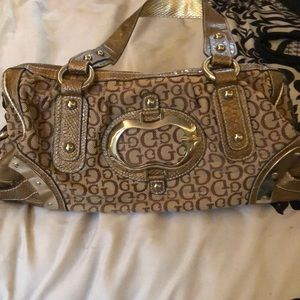 guess handbag with floral print inside!